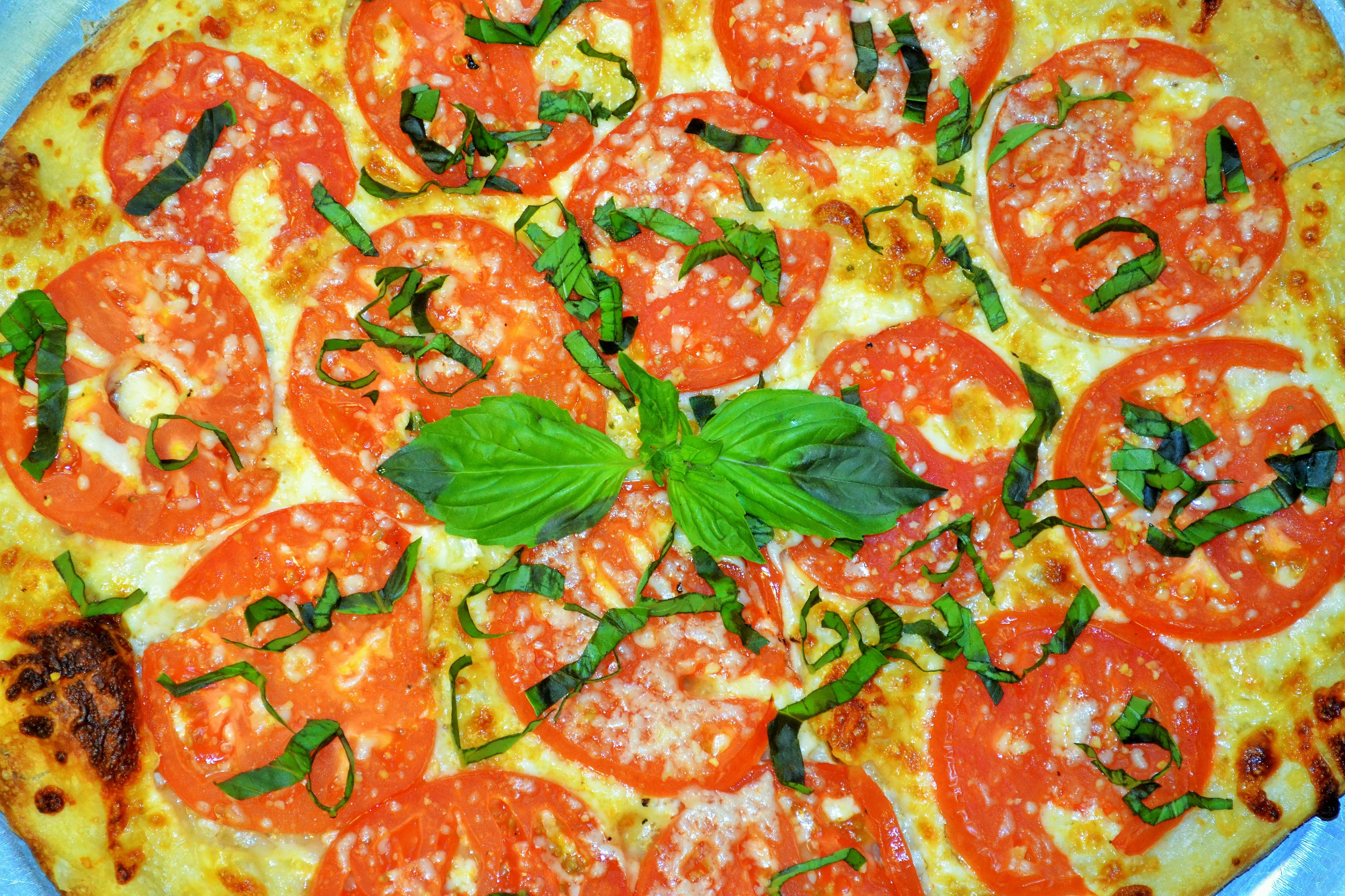 hot tomatoes pizza seasonal tomato basil. Black Bedroom Furniture Sets. Home Design Ideas